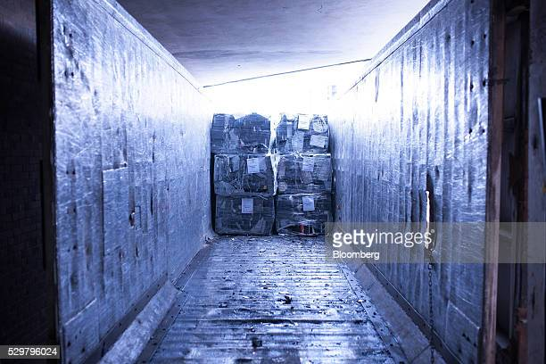A transport truck is loaded with scrap metal from recycled electronics at the ADL Process Inc facility in Toronto Ontario Canada on Monday May 2 2016...