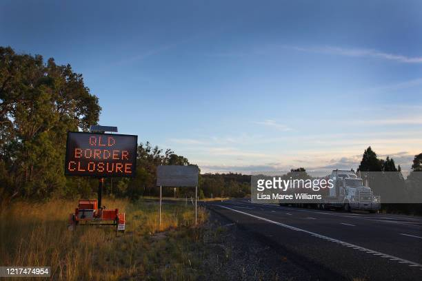 Transport truck makes it's way past a border closure sign north of the Queensland border patrol units on April 02, 2020 in Wallangarra, Australia....