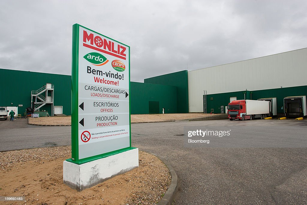 Transport trucks are seen near a sign at the distribution area of the Monliz-Produtos Alimentares do Mondego e Liz SA frozen food factory in Alpiarca, Portugal, on Friday, Jan. 18, 2013. Portuguese Prime Minister Pedro Passos Coelho says he does not want Portugal to get a second rescue program. Photographer: Mario Proenca/Bloomberg via Getty Images
