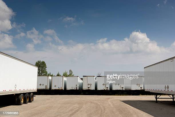 transport trucks ready to deliver freight - trailer stock pictures, royalty-free photos & images