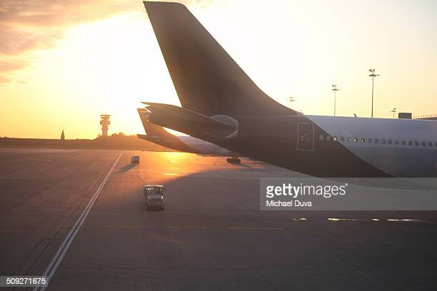 Transport vehicles on the tarmac with airplane