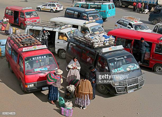 Transport vehicles wait for clients to leave El Alto 12 km from La Paz to other communities of the Bolivian altiplano 11 March 2005 With a population...