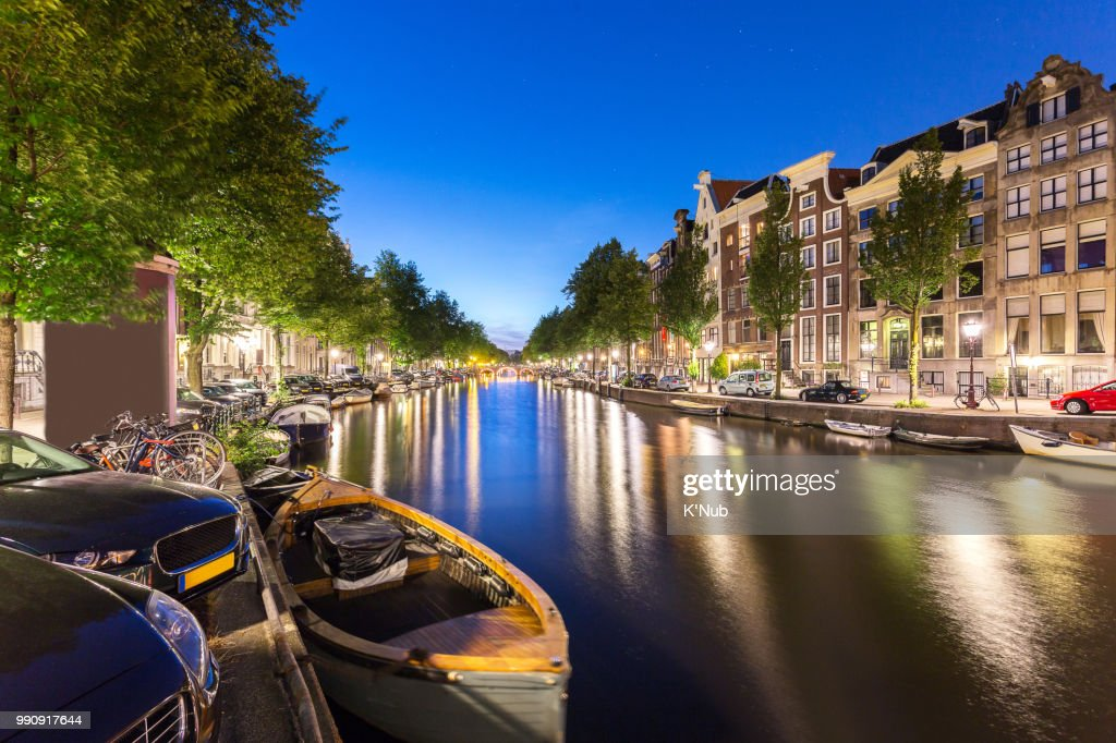 Transportation Boat Bicycle Car And Apartment House Along Amsterdam C With