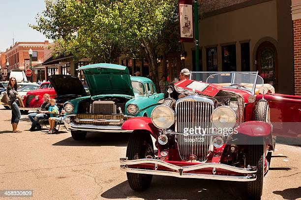 transportation:  classic vintage vehicle show in downtown city area. - car show stock pictures, royalty-free photos & images