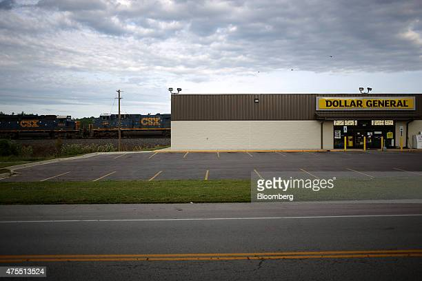 Transportation Corp train passes behind a Dollar General Corp store in Bonnieville Kentucky US on Tuesday May 26 2015 Dollar General Corp is expected...