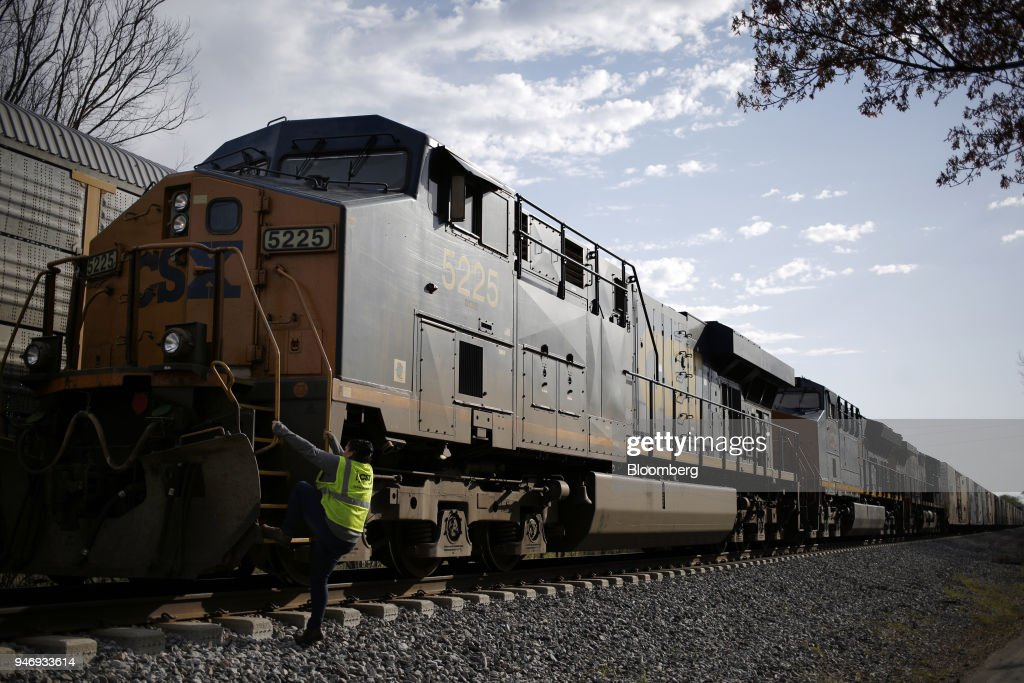 Transportation Inc. conductor climbs aboard a freight train in Bowling Green, Kentucky, U.S., on Friday, April 13, 2018. CSX Corp. is scheduled to release earnings figures on April 17. Photographer: Luke Sharrett/Bloomberg via Getty Images