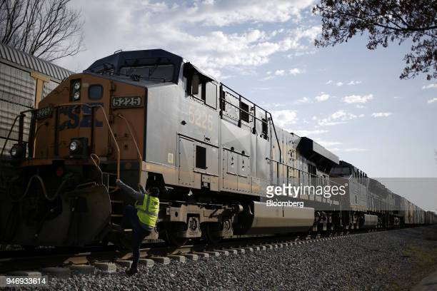 Transportation Inc conductor climbs aboard a freight train in Bowling Green Kentucky US on Friday April 13 2018 CSX Corp is scheduled to release...