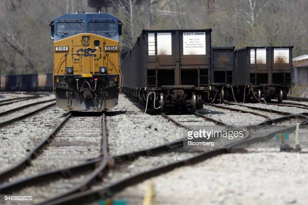 Transportation Inc freight locomotive sits parked next to empty coal trains at a rail yard in Danville West Virginia US on Saturday April 14 2018 CSX...