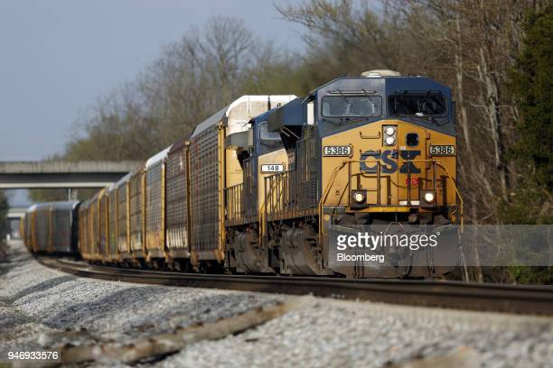 CSX Transportation Inc freight locomotives pull an autorack train in Bowling Green Kentucky US on Friday April 13 2018 CSX Corp is scheduled to...