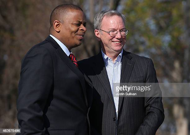 S Transportation Secretary Anthony Foxx and Google Chairman Eric Schmidt inspect a Google selfdriving car at the Google headquarters on February 2...