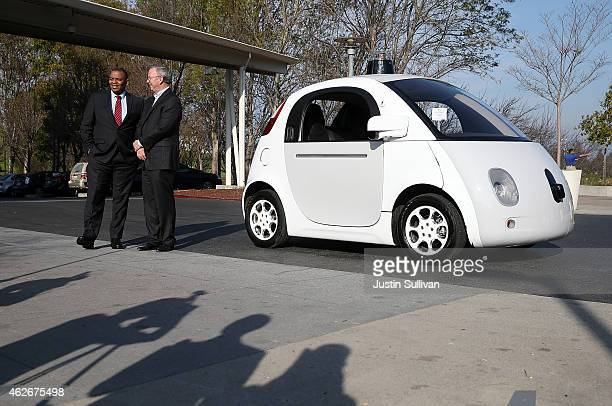 S Transportation Secretary Anthony Foxx and Google Chairman Eric Schmidt stand next to a Google selfdriving car at the Google headquarters on...