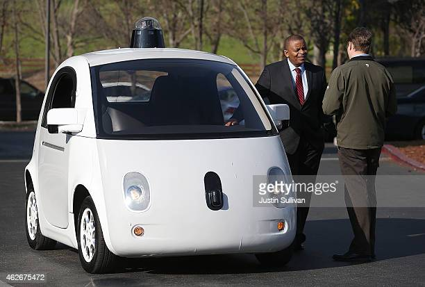 S Transportation Secretary Anthony Foxx inspects a Google selfdriving car at the Google headquarters on February 2 2015 in Mountain View California...