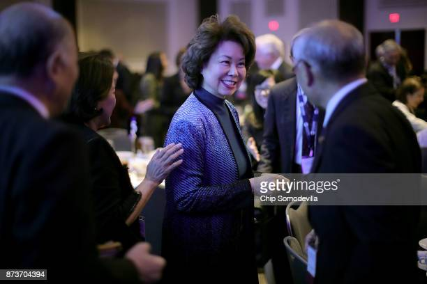 S Transportation Secretary Elaine Chao greets fellow officials before delivering keynote remarks during the USJapan Council's annual conference at...