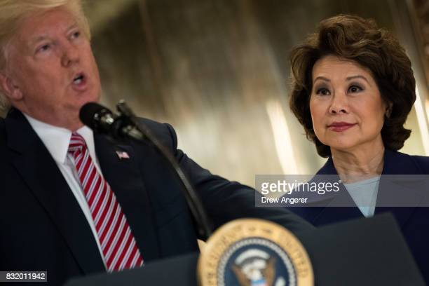Transportation Secretary Elaine Chao looks on as President Donald Trump speaks following a meeting on infrastructure at Trump Tower August 15 2017 in...