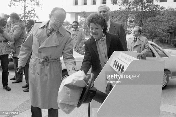 Transportation Secretary Elizabeth Dole and Ford Motor Company Chairman Donald Petersen watch a demonstration of air bags to be installed in the...