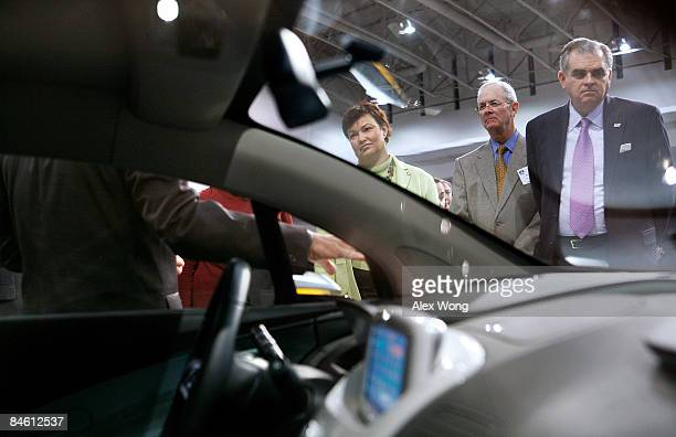 Transportation Secretary Ray LaHood and Environmental Protection Agency Administrator Lisa Jackson listen to an introduction of a Chevrolet Volt a...