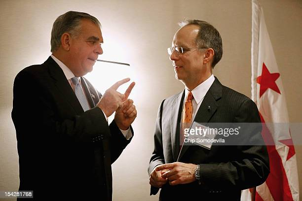 Transportation Secretary Ray LaHood and JetBlue CEO Dave Barger talk during an Aero Club luncheon at the Captial Hilton October 17 2012 in Washington...