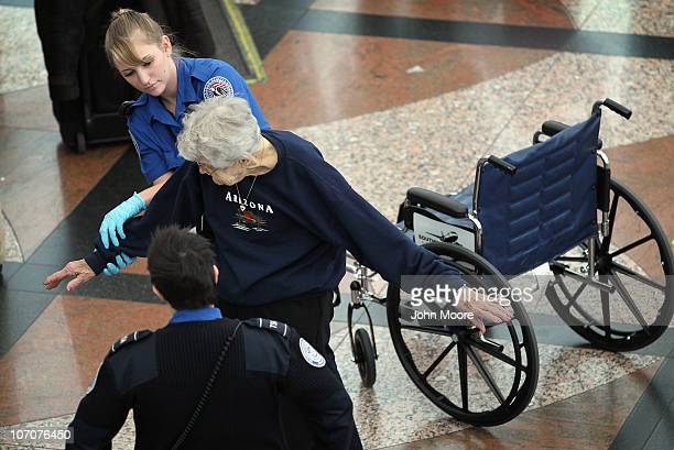 Transportation Security Administration agent performs an enhanced pat down on an elderly traveler at the Denver International Airport on November 22...