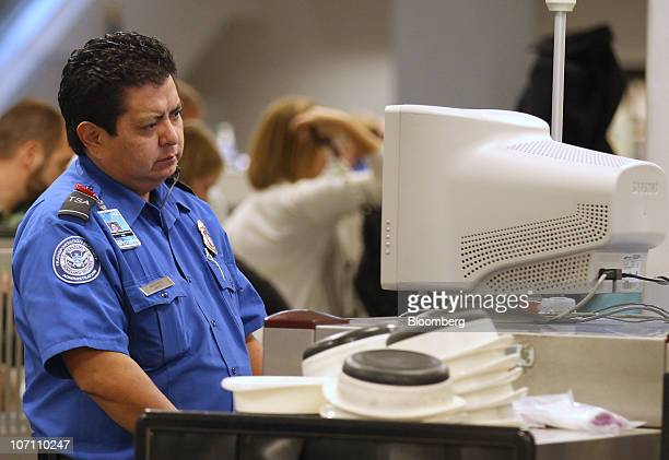 A US Transportation Security Administration agent screens carryon luggage at the Salt Lake City International Airport in Salt Lake City Utah US on...
