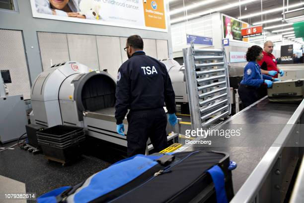 A Transportation Security Administration agent works in a checkedbag screening area at O'Hare International Airport in Chicago Illinois US on Tuesday...