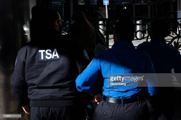 Transportation Security Administration agents walk through Terminal B at LaGuardia Airport in the Queens borough of New York US on Friday Jan 25 2019...