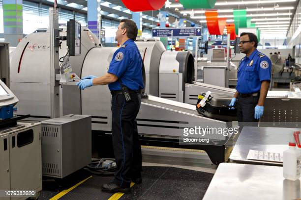 Transportation Security Administration agents work in a checkedbag screening area at O'Hare International Airport in Chicago Illinois US on Tuesday...