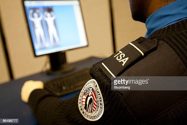 A Transportation Security Administration employee demonstrates the Backscatter advanced imaging technology scan currently in testing at the TSA...