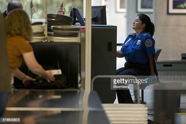 A Transportation Security Administration officer operates an xray machine in the TSA precheck area at Dulles International Airport in Dulles Virginia...