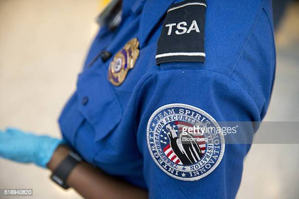 A Transportation Security Administration officer stands in the TSA precheck area at Dulles International Airport in Dulles Virginia US on Wednesday...