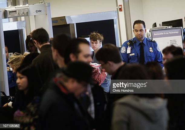 Transportation Security Administration officer watches over a line of people awaiting security screening November 24 2010 at LaGuardia airport in the...