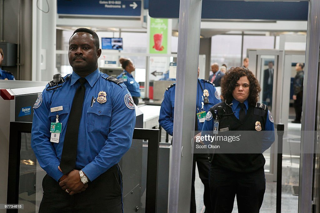 transportation security administration tsa officers staff a checkpoint at ohare international airport