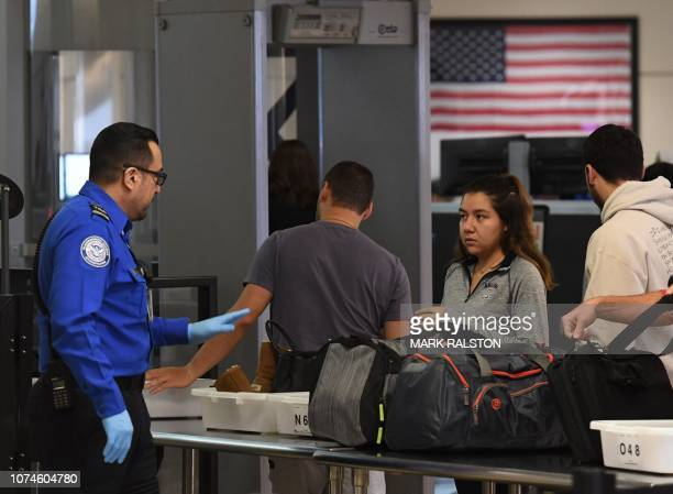 Transportation Security Administration officers work unpaid on the first day of the US government shutdown at LAX Airport in Los Angeles California...