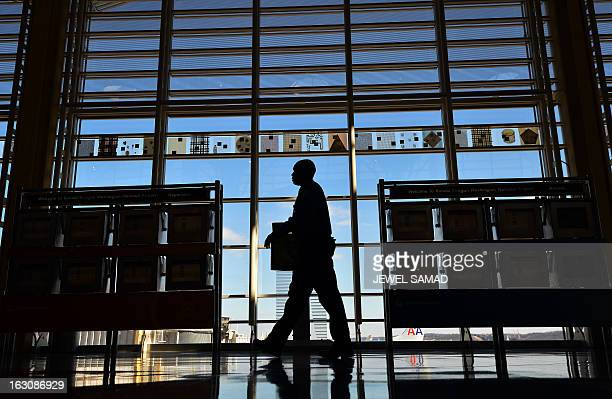 A Transportation Security Administration personnel walks to his post at the Ronald Reagan National Airport in Washington DC on March 4 2013 US...