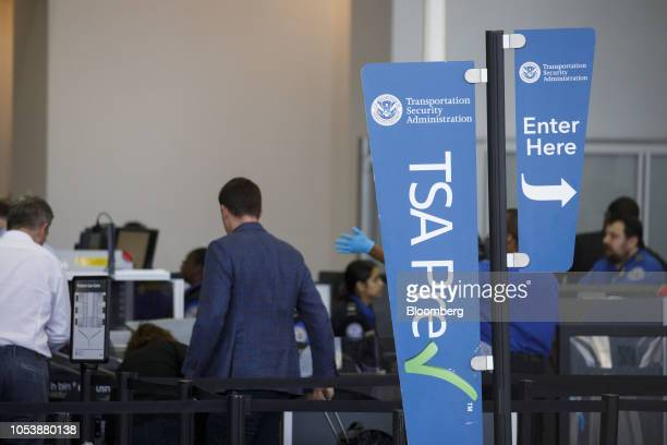 Transportation Security Administration PreCheck sign is displayed as travelers carry baggage through a security checkpoint at Los Angeles...