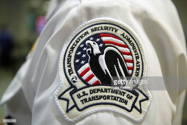 Transportation Security Administration wears his patch at the Miami International Airport September 30 2003 in Miami The deadline for the agency to...