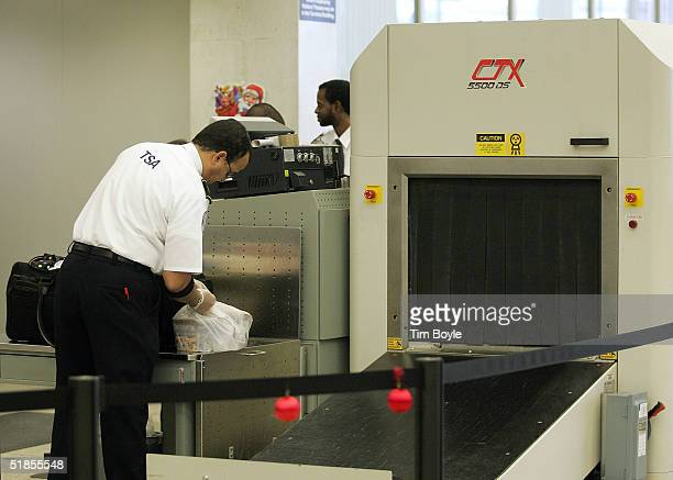 S Transportation Security Administration worker checks baggage content what turned out to be ice cream after it passed through a CTX explosives...
