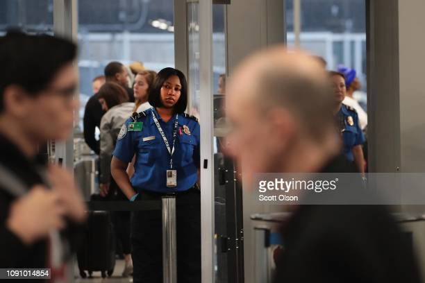 Transportation Security Administration worker screens passengers and airport employees at O'Hare International Airport on January 07 2019 in Chicago...