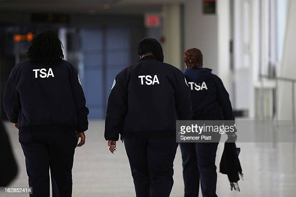 Transportation Security Administration workers walk through John F Kennedy Airport on February 28 2013 in New York City Should the $85 billion in...
