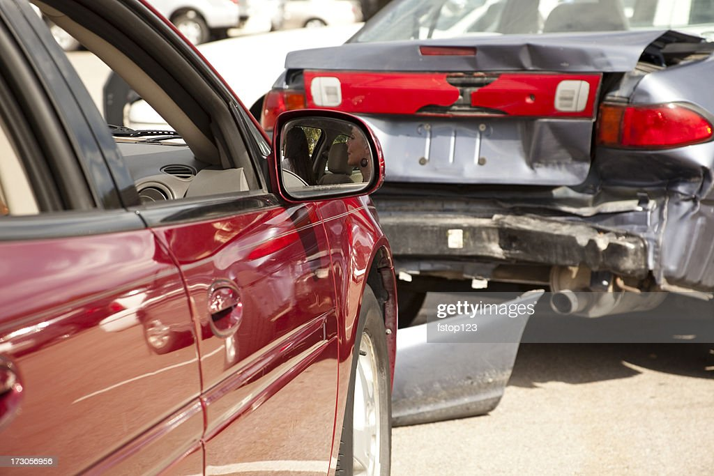 Transportation: Two-car accident, wreck with people still inside red vehicle. : Stock Photo