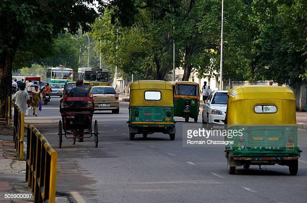 Transportation via Tuk-tuk, India.