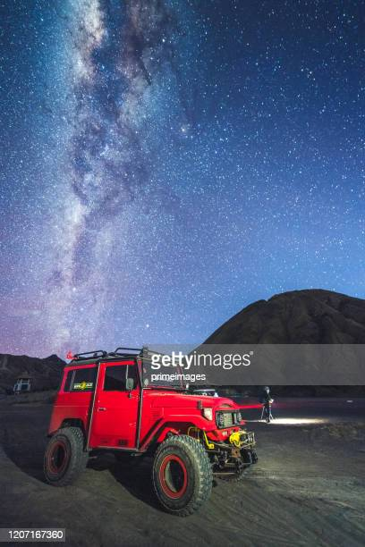 transportation with astrophoto starry night milky way at volcano mt.bromo east java indonesia - mt semeru stock pictures, royalty-free photos & images