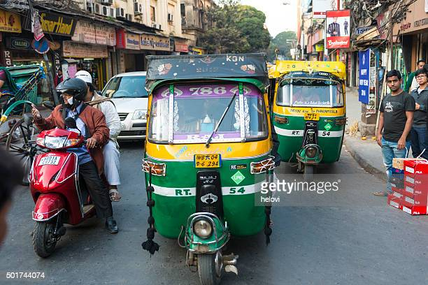 transportation with tuk-tuk in kolkata - auto rickshaw stock pictures, royalty-free photos & images