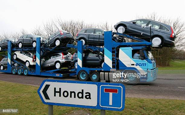 A transporter loaded with Honda cars leaves the Honda car factory in Swindon southwest England on January 30 2009 Workers at Honda's British factory...