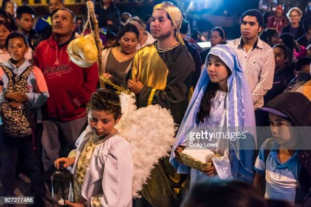 a christmas posada transporting mary and the baby jesus - san miguel de allende, mexico - mexican christmas stock pictures, royalty-free photos & images