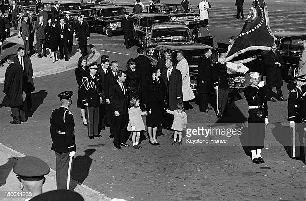 Transporting the mortal remains of President John Fitzgerald Kennedy from the White House to the Capitol with his widow Jacqueline and children John...