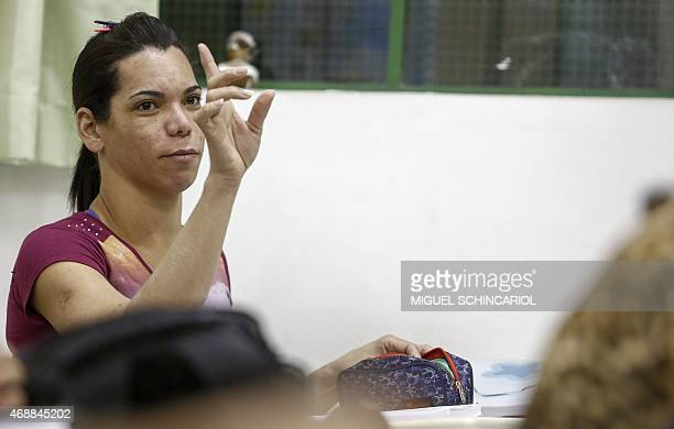 SULLEIRO A transsexual attends a class of the TransCidadania program which provides scholarships for transvestites and transsexuals in Sao Paulo...