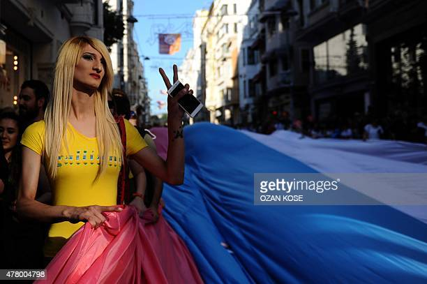 A transsexual flashes victory sign during Transgender Pride march along Istikbal Avenue in Istanbul on June 21 2015 AFP PHOTO / OZAN KOSE