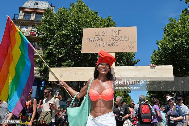 A transsexual holds a cross like Jesus to ask for the right to use their own body as they want as thousands of people gather to support gay rights by...