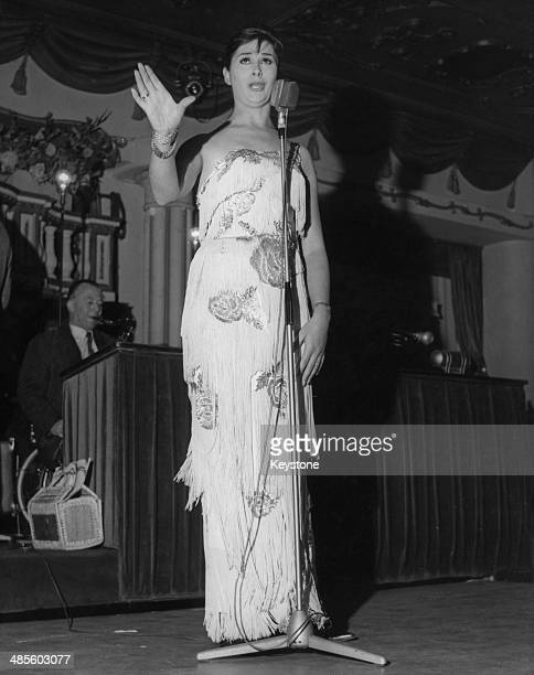 Transsexual model and performer April Ashley singing at the Astor Club in London's West End 1962