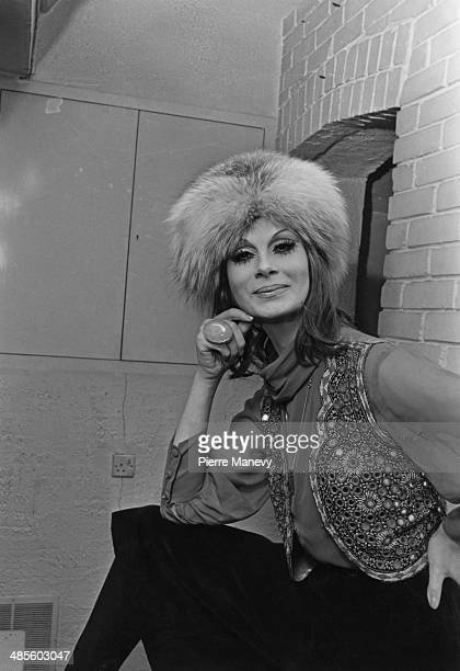 Transsexual model April Ashley wearing a fur hat and embellished waistcoat 1st February 1970